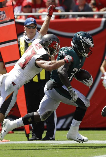 (AP Photo/Chris O'Meara). Philadelphia Eagles running back Corey Clement (30) runs for a touchdown as Tampa Bay Buccaneers defensive back Chris Conte (23) attempts to tackle, during the first half of an NFL football game, Sunday, Sept. 16, 2018, in Tam...