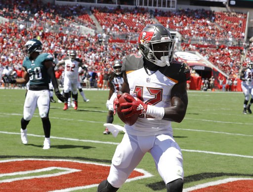 (AP Photo/Chris O'Meara). Tampa Bay Buccaneers wide receiver Chris Godwin (12) grabs a touchdown pass during the first half of an NFL football game against the Philadelphia Eagles, Sunday, Sept. 16, 2018, in Tampa, Fla.