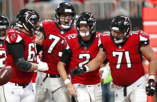 (AP Photo/John Bazemore). Atlanta Falcons quarterback Matt Ryan (2) celebrates his touchdown with team mates during the second half of an NFL football game against the Carolina Panthers, Sunday, Sept. 16, 2018, in Atlanta.