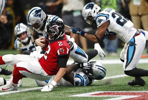 (AP Photo/John Bazemore). Atlanta Falcons quarterback Matt Ryan (2) leaps for a touchdown as Carolina Panthers linebacker Shaq Green-Thompson (54) defends during the second half of an NFL football game, Sunday, Sept. 16, 2018, in Atlanta.