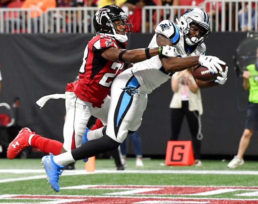 (AP Photo/John Amis). Carolina Panthers wide receiver Torrey Smith (11) makes a touchdown catch against Atlanta Falcons defensive back Robert Alford (23) during the second half of an NFL football game, Sunday, Sept. 16, 2018, in Atlanta.