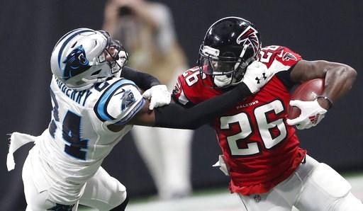 (AP Photo/John Bazemore). Atlanta Falcons running back Tevin Coleman (26) runs against Carolina Panthers cornerback James Bradberry (24) during the second half of an NFL football game, Sunday, Sept. 16, 2018, in Atlanta.