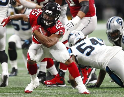 (AP Photo/John Bazemore). Atlanta Falcons running back Ito Smith (25) runs past Carolina Panthers linebacker Shaq Green-Thompson (54) during the second half of an NFL football game, Sunday, Sept. 16, 2018, in Atlanta.