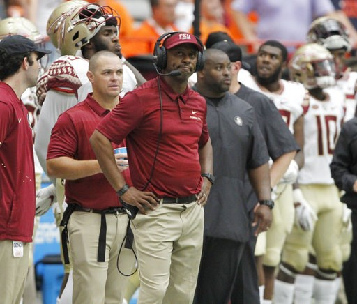 (AP Photo/Nick Lisi). Florida State head coach Willie Taggart looks at the scoreboard late in the fourth quarter of an NCAA college football game against Syracuse in Syracuse, N.Y., Saturday, Sept. 15, 2018. Syracuse won 30-7.