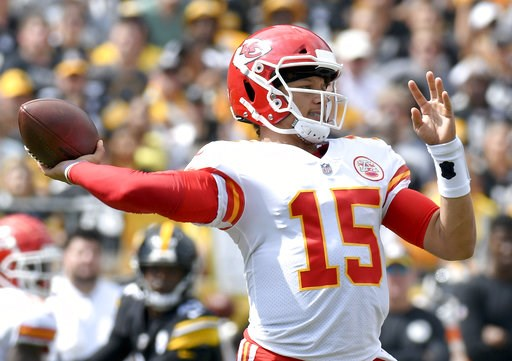 (AP Photo/Don Wright). Kansas City Chiefs quarterback Patrick Mahomes (15) plays in the first quarter of an NFL football game against the Pittsburgh Steelers, Sunday, Sept. 16, 2018, in Pittsburgh.