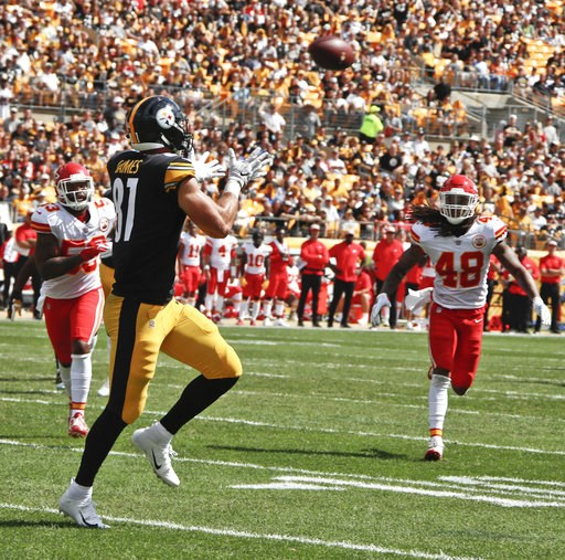 (AP Photo/Gene J. Puskar). Pittsburgh Steelers tight end Jesse James (81) makes a catch for a touchdown past Kansas City Chiefs linebacker Terrance Smith (48) in the first half of an NFL football game, Sunday, Sept. 16, 2018, in Pittsburgh.