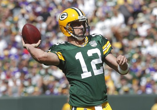 (AP Photo/Morry Gash). Green Bay Packers' Aaron Rodgers throws during the second half of an NFL football game against the Minnesota Vikings Sunday, Sept. 16, 2018, in Green Bay, Wis.