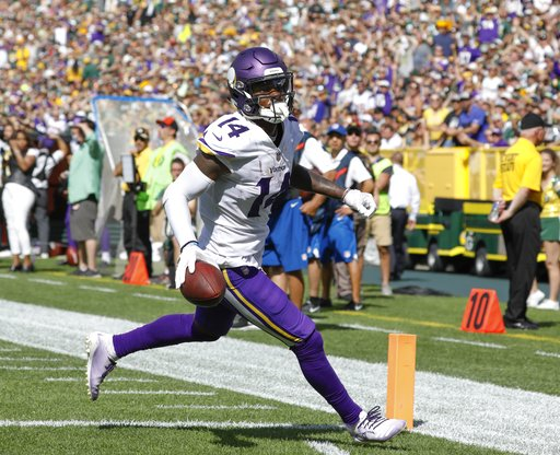 (AP Photo/Jeffrey Phelps). Minnesota Vikings' Stefon Diggs catches a touchdown pass during the second half of an NFL football game against the Green Bay Packers Sunday, Sept. 16, 2018, in Green Bay, Wis.