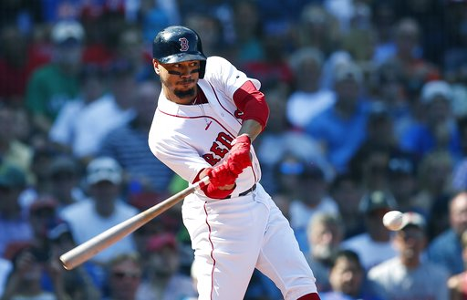 (AP Photo/Michael Dwyer). Boston Red Sox's Mookie Betts hits a sacrifice fly that scored Rafael Devers during the third inning of a baseball game against the New York Mets in Boston, Sunday, Sept. 16, 2018.