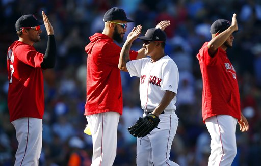 (AP Photo/Michael Dwyer). Boston Red Sox's Tzu-Wei Lin, center right, celebrates with pitchers, from left, Nathan Eovaldi, David Price and Eduardo Rodriguez after defeating the New York Mets during a baseball game in Boston, Sunday, Sept. 16, 2018.