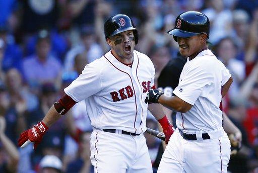 (AP Photo/Michael Dwyer). Boston Red Sox's Steve Pearce, left, reacts after Tzu-Wei Lin, right, scored the go-ahead run on a sacrifice fly by Andrew Benintendi during the eighth inning of a baseball game against the New York Mets in Boston, Sunday, Sep...