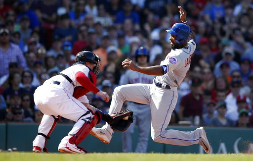 (AP Photo/Michael Dwyer). New York Mets' Austin Jackson, right, scores against Boston Red Sox's Christian Vazquez on a sacrifice fly by Wilmer Flores during the sixth inning of a baseball game in Boston, Sunday, Sept. 16, 2018.