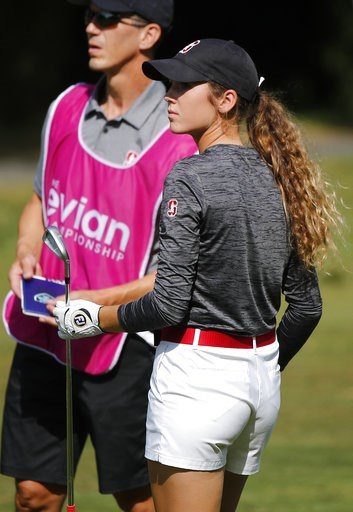 (AP Photo/Francois Mori). Rachel Heck of the U.S. walks on the fairway during the fourth round of the Evian Championship women's golf tournament in Evian, eastern France, Sunday, Sept. 16, 2018.