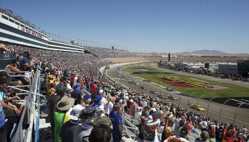 (AP Photo/Isaac Brekken). Fans stand for the beginning of a NASCAR Cup Series auto race Sunday, Sept. 16, 2018, in Las Vegas.