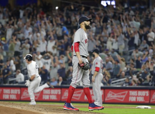 (AP Photo/Frank Franklin II). Boston Red Sox starting pitcher David Price walks on the mound as New York Yankees' Luke Voit runs the bases after hitting a two-run home run during the sixth inning of a baseball game Wednesday, Sept. 19, 2018, in New York.