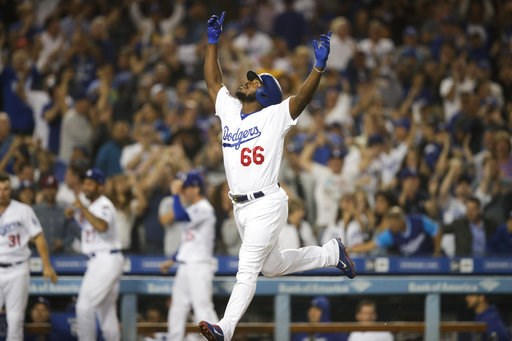 (AP Photo/Jae C. Hong). Los Angeles Dodgers' Yasiel Puig celebrates his three-run home run during the seventh inning against the Colorado Rockies in a baseball game Wednesday, Sept. 19, 2018, in Los Angeles.