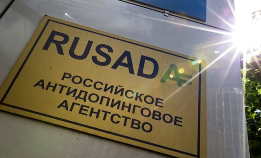 """(AP Photo/Alexander Zemlianichenko, FILE). FILE -The May 24, 2016 file photo shows a RUSADA sign reading """"Russian National Anti-doping Agency"""" on a building in Moscow, Russia.  The World Anti-Doping Agency is due to vote Thursday Sept. 20, 2018, on pos..."""