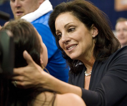 (AP Photo/Phil Sandlin, FIle). FILE - In this April 23, 2010, file photo, UCLA gymnastics coach Valorie Kondos Field, right, congratulates a member of her team after they won the NCAA gymnastics championships, in Gainesville, Fla. Longtime UCLA women's...