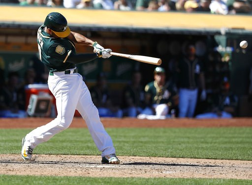 (AP Photo/Tony Avelar). Oakland Athletics' Marcus Semien hits a double to drive in three runs against the Los Angeles Angels during the sixth inning of a baseball game in Oakland, Calif., Thursday, Sept. 20, 2018.