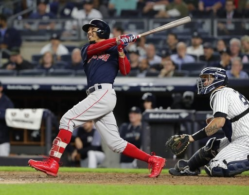 (AP Photo/Frank Franklin II). Boston Red Sox's Mookie Betts watches his three-run home run during the eighth inning of a baseball game against the New York Yankees on Thursday, Sept. 20, 2018, in New York.