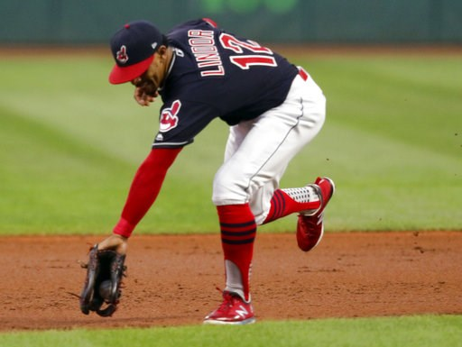 (AP Photo/Tom E. Puskar). Cleveland Indians' Francisco Lindor fields a ball hit by Chicago White Sox's Omar Narvaez during the first inning of a baseball game, Thursday, Sept. 20, 2018, in Cleveland. Narvaez was out at first.