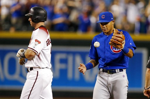 (AP Photo/Ross D. Franklin). Chicago Cubs shortstop Addison Russell, right, flips the ball in the air after tagging out Arizona Diamondbacks' Paul Goldschmidt, left, trying to steal second base for the final out during the ninth inning of a baseball ga...