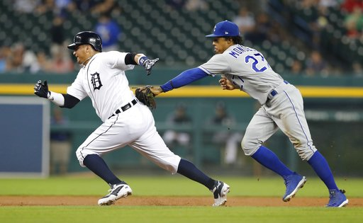 (AP Photo/Carlos Osorio). Detroit Tigers' Victor Martinez, left, is caught in a rundown by Kansas City Royals second baseman Adalberto Mondesi during the first inning of a baseball game Thursday, Sept. 20, 2018, in Detroit.
