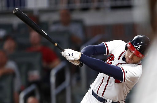 (AP Photo/John Bazemore). Atlanta Braves' Freddie Freeman drives in a run with a base hit in the third inning of a baseball game against the Philadelphia Phillies pm Friday, Sept. 21, 2018, in Atlanta.
