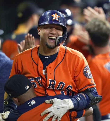 (AP Photo/David J. Phillip). Houston Astros' Yuli Gurriel (10) celebrates in the dugout after hitting a grand slam against the Los Angeles Angels during the first inning of a baseball game Friday, Sept. 21, 2018, in Houston.