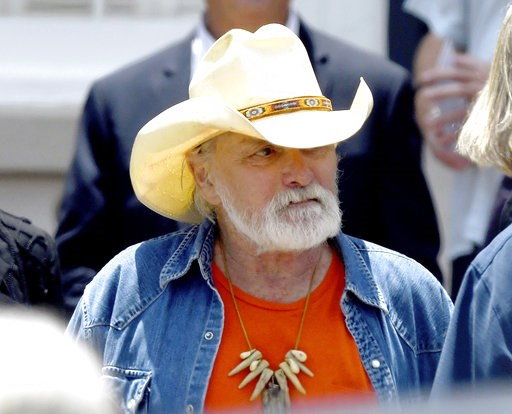 """(Jason Vorhees/The Macon Telegraph via AP, File). FILE - In this June 3, 2017, file photo, founding member of the Allman Brothers Band Dickey Betts exits the funeral of Gregg Allman at Snow's Memorial Chapel, in Macon, Ga. Betts is in """"critical but sta..."""