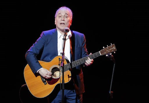 (AP Photo/Julie Jacobson, File). FILE - In a Sept. 22, 2016 file photo, musician Paul Simon performs during the Global Citizen Festival, in New York.  Simon wraps up his farewell concert tour Saturday, Sept. 22, 2018 at a park in Queens, a bicycle ride...