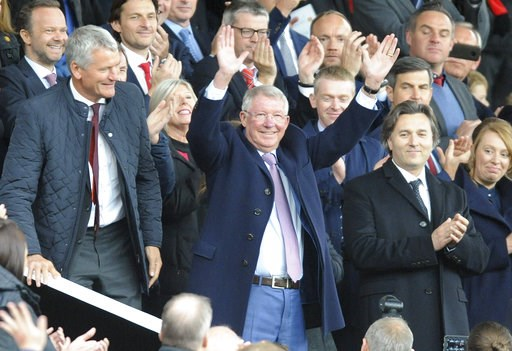(AP Photo/Rui Vieira). Former Manchester United manager Alex Ferguson waves as he takes his seat on the stands before the English Premier League soccer match between Manchester United and Wolverhampton Wanderers at Old Trafford stadium in Manchester, E...