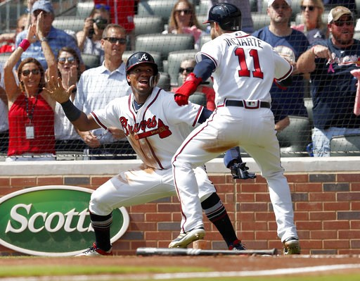 (AP Photo/John Bazemore). Atlanta Braves' Ronald Acuna Jr., left, and Ender Inciarte (11) celebrate after scoring on a two-run base hit by Freddie Freeman in the second inning of a baseball game against the Philadelphia Phillies, Saturday, Sept. 22, 20...