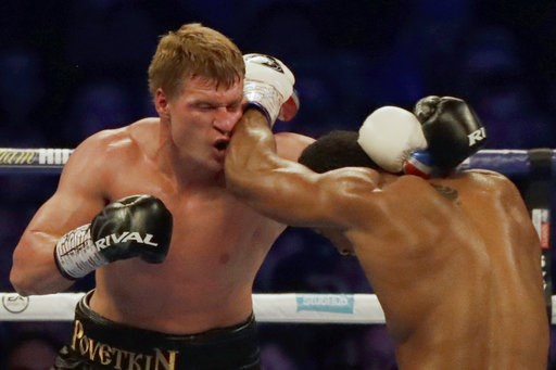 (AP Photo/Matt Dunham). British boxer Anthony Joshua, right, fights Russian boxer Alexander Povetkin in their WBA, IBF, WBO and IBO heavyweight titles fight at Wembley Stadium in London, Saturday, Sept. 22, 2018.
