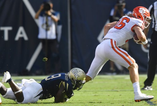 (AP Photo/Mike Stewart). Georgia Tech linebacker Victor Alexander (9) tackles Clemson quarterback Trevor Lawrence (16) during the first half of an NCAA college football game, Saturday, Sept. 22, 2018, in Atlanta.
