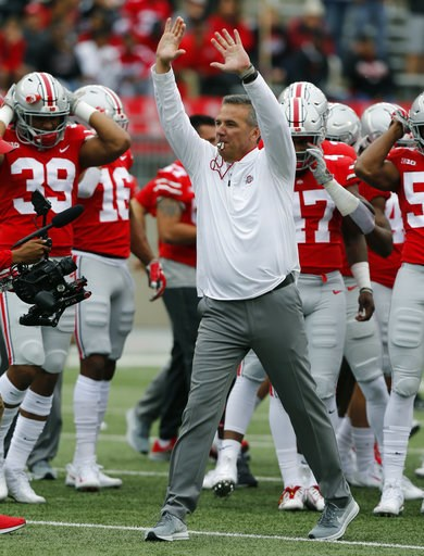(AP Photo/Jay LaPrete). Ohio State head coach Urban Meyer greets players during their warm before an NCAA college football game against Tulane Saturday, Sept. 22, 2018, in Columbus, Ohio. Meyer is returning to his coaching duties after a three-game sus...