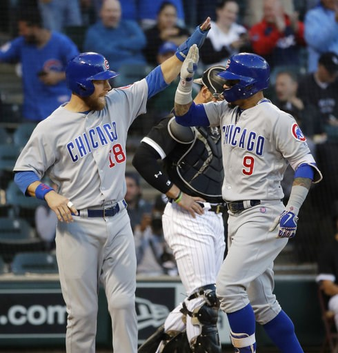 (AP Photo/Nam Y. Huh). Chicago Cubs' Javier Baez, right, celebrates with Ben Zobrist after hitting a two-run home run against the Chicago White Sox during the first inning of a baseball game Saturday, Sept. 22, 2018, in Chicago.