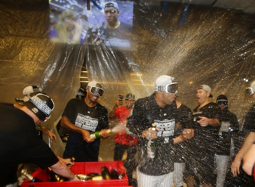 (AP Photo/Frank Franklin II). The New York Yankees celebrate after they clinched wildcard playoff birth with a 3-2 win over the Baltimore Orioles in a baseball game Saturday, Sept. 22, 2018, in New York.