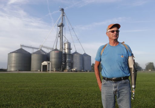 "(AP Photo/Michael Conroy). Jack Maloney poses in front of the grain bins on his Little Ireland Farms in Brownsburg, Ind., Wednesday, Sept. 12, 2018. Maloney, who farms about 2,000 acres in Hendricks Count, said the aid for farmers is ""a nice gesture"" b..."