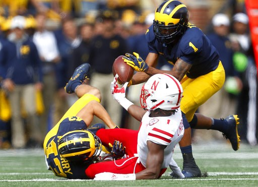 (AP Photo/Paul Sancya). Michigan's Ambry Thomas (1) recovers a fumble by Nebraska Tyjon Lindsey (1) on a punt return after Jake McCurry (43) made the tackle in the first half of an NCAA football game in Ann Arbor, Mich., Saturday, Sept. 22, 2018.