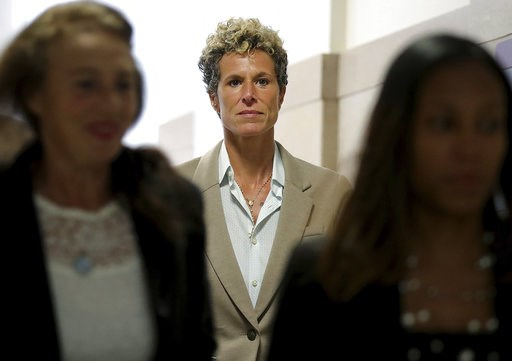 (David Maialetti/The Philadelphia Inquirer via AP, Pool). Accuser Andrea Constand returns to the courtroom during a lunch break at the sentencing hearing for Bill Cosby at the Montgomery County Courthouse in Norristown, Pa., Monday, Sept. 24, 2018.