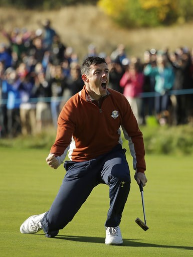 (AP Photo/Matt Dunham). Europe's Rory McIlroy celebrates after holing a putt to halve the 5th during a fourball match on the second day of the 42nd Ryder Cup at Le Golf National in Saint-Quentin-en-Yvelines, outside Paris, France, Saturday, Sept. 29, 2...