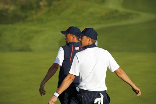 (AP Photo/Francois Mori). Jordan Spieth, right, and his teammate Justin Thomas walk off the 12th tee during their foursome match on the second day of the 2018 Ryder Cup at Le Golf National in Saint Quentin-en-Yvelines, outside Paris, France, Saturday, ...