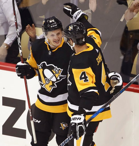 (AP Photo/Gene J. Puskar). Pittsburgh Penguins' Jake Guentzel (59) celebrates his goal with Justin Schultz during the first period of an NHL hockey game against the Washington Capitals in Pittsburgh, Thursday, Oct. 4, 2018.