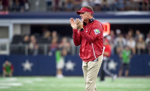 (AP Photo/Jeffrey McWhorter). Arkansas head coach Chad Morris during the first half of an NCAA college football game, Saturday, Sept. 29, 2018, in Arlington, Texas.