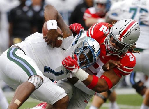 (AP Photo/Jay LaPrete, File). FILE - In this Sept. 22, 2018, file photo, Ohio State defensive end Chase Young, right, sacks Tulane quarterback Jonathan Banks during the first half of an NCAA college football game, in Columbus, Ohio.n Indiana plays at O...