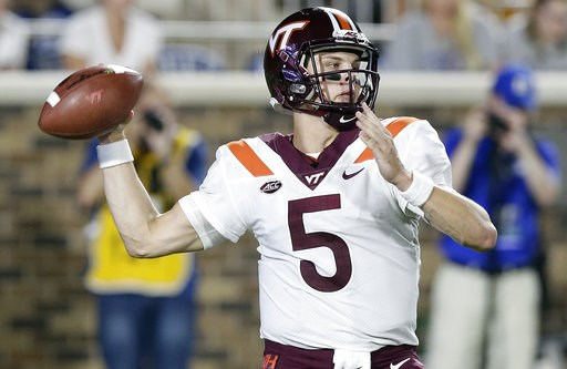 (AP Photo/Gerry Broome, File). FILE - In this Sept. 29, 2018, file photo, Virginia Tech quarterback Ryan Willis (5) passes during the first half of an NCAA college football game against Duke, in Durham, N.C. The Hokies have made a change behind center,...