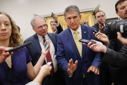 (AP Photo/Pablo Martinez Monsivais). Sen. Joe Manchin, D-W. Va., right, and Sen. Tim Kaine, D-Va., left, walk together after viewing the FBI supplemental background report on Supreme Court Justice nominee Brett Kavanaugh in the SCIF in the Capitol in W...