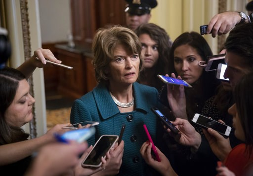 (AP Photo/J. Scott Applewhite). Republican Sen. Lisa Murkowski of Alaska, speaks with reporters just after a deeply divided Senate pushed Brett Kavanaugh's Supreme Court nomination past a key procedural hurdle, setting up a likely final showdown vote f...