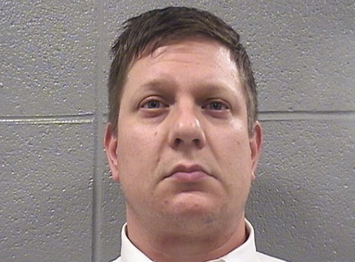 (Cook County Sheriff's Office via AP). This Oct. 5, 2018 photo provided by the Cook County Sheriff's Office in Chicago, Ill., shows Jason Van Dyke. Van Dyke, a Chicago police Officer, was taken into custody and photographed, after jurors found him guil...